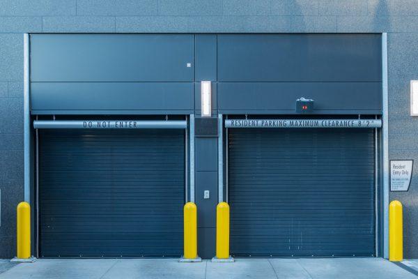 Closed Parking Garage Doors in urban apartment building